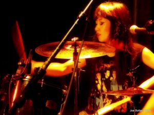 Hitomi on drums with Rockaway Bitch.