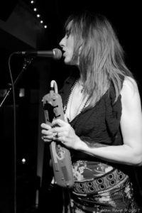 Karmen Guy - Vocals and Melodica (Photographer - Alan Rand)